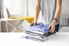 Ironing clothes on ironing board Stock Image