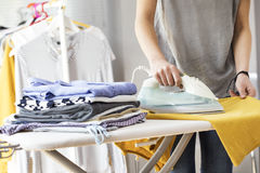 Ironing clothes on ironing board Royalty Free Stock Image