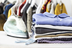 Ironing clothes on ironing board Royalty Free Stock Photography