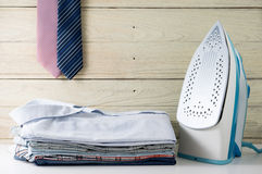 Ironing clothes with shirts Royalty Free Stock Photography