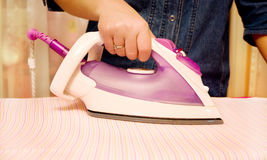 Ironing clothes with steam iron Stock Photos
