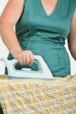 Ironing clothes Stock Photo