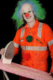 Ironing clown. Clown in costume with iron royalty free stock image