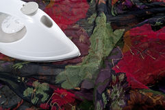 Ironing colorful silk fabric Stock Images