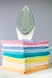 Ironing colorful towels Royalty Free Stock Image