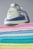 Ironing colorful towels Stock Photos