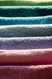 Ironing colorful towels. Housework, ironing iron colorful towels on the ironing board Royalty Free Stock Photography