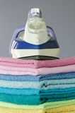 Ironing colorful towels Stock Image