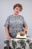 Ironing Day. A woman does her ironing Stock Photos