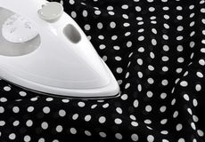Ironing delicate polka fabric Stock Photo