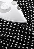 Ironing delicate silky fabric Royalty Free Stock Images