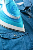 Ironing denim shirt Stock Images