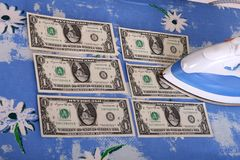Ironing dollars Royalty Free Stock Photo
