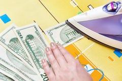 Ironing dollars banknote Royalty Free Stock Image