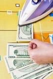 Ironing dollars banknote Stock Image