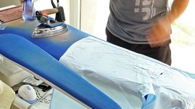 Ironing in Dry Cleaning Shop stock video footage