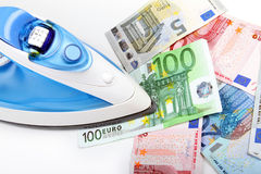 Ironing euro money Stock Photography