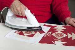 Ironing fabric of pieced paper foundation Royalty Free Stock Photography
