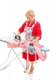 Ironing Full Body. Retro senior grandmother does the ironing.  Full body  on white Stock Image