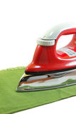 Ironing a green cloth Stock Photo