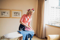 Ironing housewife royalty free stock images