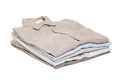Ironing housework ironed folded shirts clean white background. Ironing housework ironed folded shirts clean concept still life garment apparel cloth indoors Royalty Free Stock Image