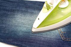 Ironing jeans Stock Photos