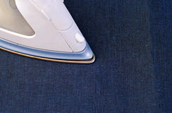 Ironing jeans cloth Stock Images