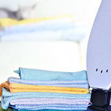 Ironing linen with iron stock images