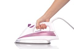 Ironing with a modern steam flat iron Royalty Free Stock Images