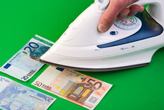 Ironing money Royalty Free Stock Photo