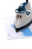 Ironing out the economy. Iron on a stock report to indicate ironing out the economy stock image