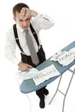Ironing out problems 5. Metaphor - a businessman ironing out problems Stock Photography