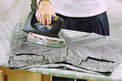 Ironing on paillettes Royalty Free Stock Images