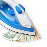Ironing the paper currency Stock Photo