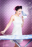 Ironing pinup housewife doing sixties housework Royalty Free Stock Photos