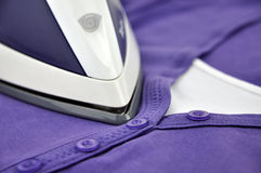 Ironing Purple Clothes Stock Photography