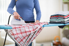 Ironing requires patience Royalty Free Stock Photo