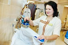 Ironing service Stock Images
