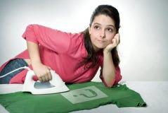 Ironing shirt. Young woman bored of ironing shirt Stock Photos