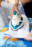 Ironing shirt Royalty Free Stock Images