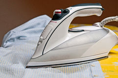 Ironing a shirt Royalty Free Stock Image