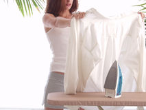Ironing a shirt. Young woman Ironing a shirt Royalty Free Stock Photos