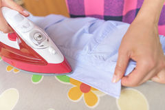 Ironing a shirt collar. Stock Images