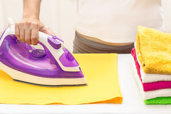 Ironing on the table at home.  Stock Photo