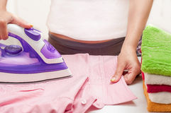 Ironing on the table at home.  Royalty Free Stock Images