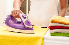 Ironing on the table at home.  Royalty Free Stock Photos