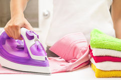 Ironing on the table at home.  Stock Image