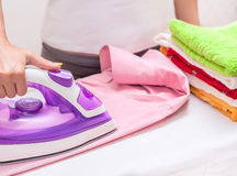 Ironing on the table at home.  Stock Photos