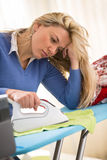 Ironing is tiring and boring job stock photo